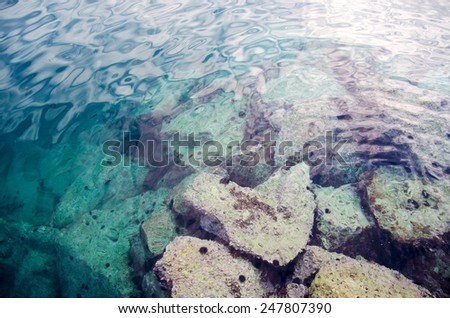 See water abstract background with stones - stock photo