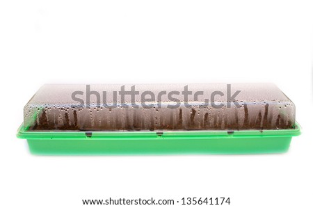 seed tray box with lid on collecting condensation - stock photo