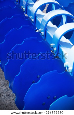 Seeder, blue disc harrow for tillage - stock photo
