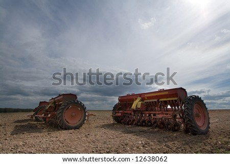 Seeding machines at field at sunny day. - stock photo