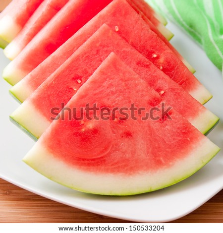 Seedless watermelon slices on a plate. selective focus - stock photo
