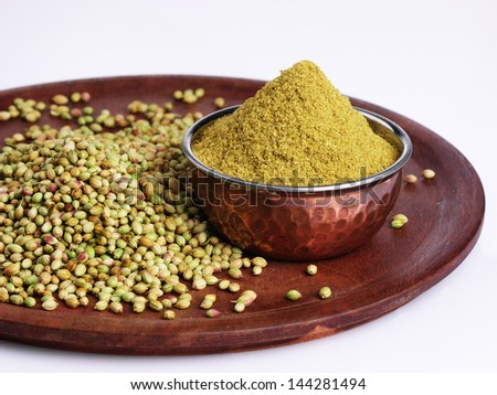 seeds and powder of coriander spice  on white background - stock photo