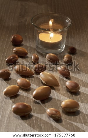 seeds of argan a close up on wood - stock photo