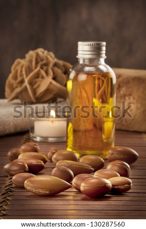 seeds of argan with light and soap a close up - stock photo