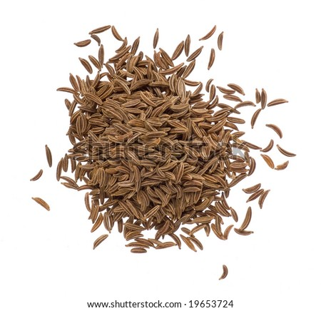 Seeds of dried caraway closeup isolated on white