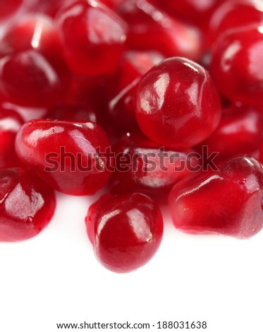 Seeds of pomegranate isolated on white