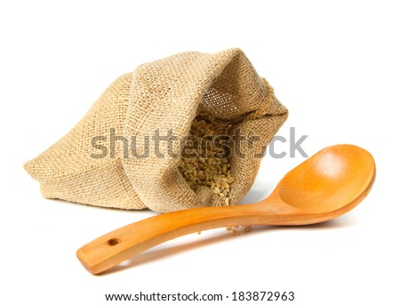 seeds of wheat in bag and spoon on white background