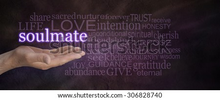 Seeking a soul mate - male hand palm up with the word soul mate floating above, surrounded by a word cloud on a deep purple stone effect wide background - stock photo