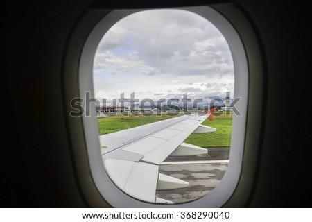 seen through window of an aircraft - stock photo
