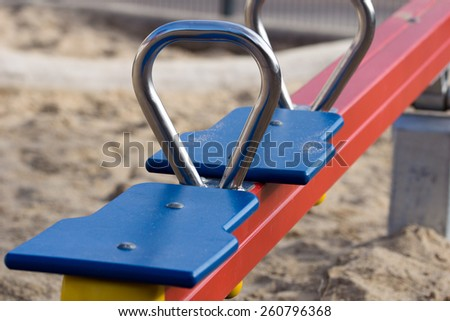 Seesaw for children on a playground / Playground - stock photo
