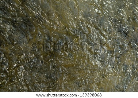 Seething surface of sea water shot in the open sea directly from above - stock photo