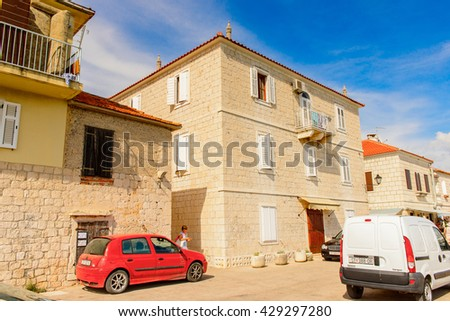 SEGET, CROATIA - AUG 20, 2014: Seget town at the Adriatic coast. Coast of the Adriatic Sea in Dalmatia became a popular destination for millions of tourists