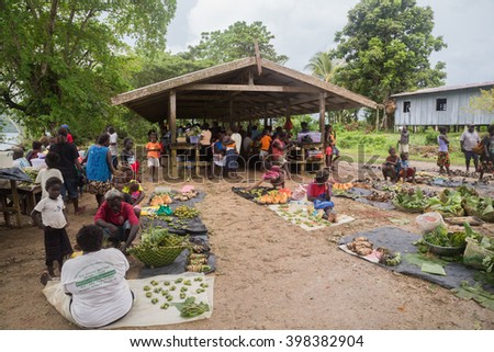 Seghe, Solomon Islands - June 16, 2015: People buying and selling food at the local market in the village of Seghe.
