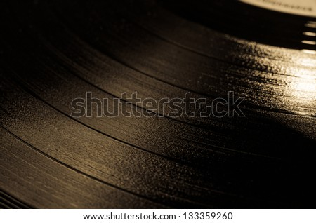 Segment of vinyl record with label showing the texture of the grooves , retro look - stock photo