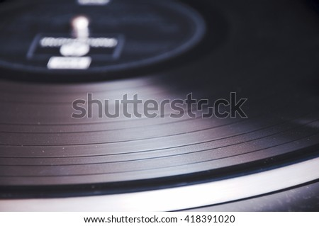 Segment of vinyl record with label showing the texture of the grooves, retro look , with copyspace - stock photo