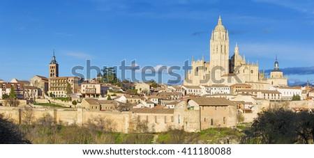 Segovia -  Cathedral Nuestra Senora de la Asuncion y de San Frutos de Segovia and the wall of town in evening light. - stock photo