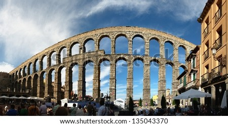SEGOVIA - JULY 12: People waiting for the concert to start, which is taking place under the old roman aqueduct on July 12, 2012 in Segovia, Spain - stock photo