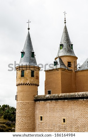 SEGOVIA, SPAIN - APR 5, 2014: Alcazar of Segovia (Segovia Castle), a stone fortification, Segovia, Spain. It's one of the inspirations for Walt Disney's Cinderella Castle. - stock photo