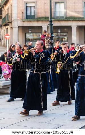 SEGOVIA, SPAIN - APR 5, 2014: Unidentified people of Segovia make the performance dedicated to Easter approximation in the Old town in Segovia, Spain. Old Town of Segovia is the UNESCO World Heritage