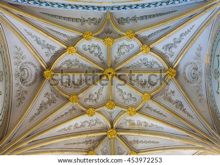 SEGOVIA, SPAIN, APRIL - 14, 2016: The gothic vault of side chapel in Cathedral of Our Lady of Assumption with the neoclassicistic frescoes.