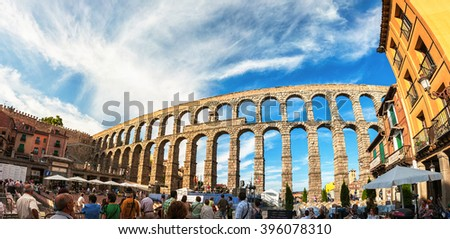 SEGOVIA, SPAIN - JULY 12, 2012: People waiting for the concert to start, which is taking place under the old roman aqueduct. famous landmark in the city - stock photo