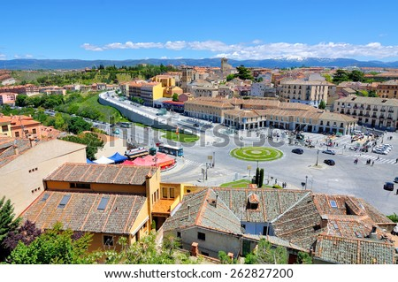 SEGOVIA, SPAIN - JUNE 2 - 2013: Aerial view of old city in Castile and Leon declared World Heritage Sites by UNESCO. People at Plaza Artilleria, shops, restaurants, bars  - stock photo