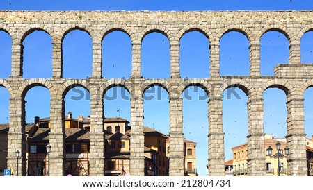 SEGOVIA, SPAIN - JUNE 09, 2014: The Roman aqueduct. Aqueduct was built during the second half of the 1st century A.D. and supplied water from the Frio River to the city into the 20th century.  - stock photo