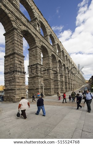 Segovia, Spain - May 30, 2016: People walk near the Roman aquaduct in the town of Segovia, Spain on May 30, 2016