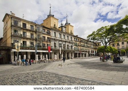 Segovia, Spain - May 30, 2016: People walking on the town square in Segovia, Spain on May 30, 2016