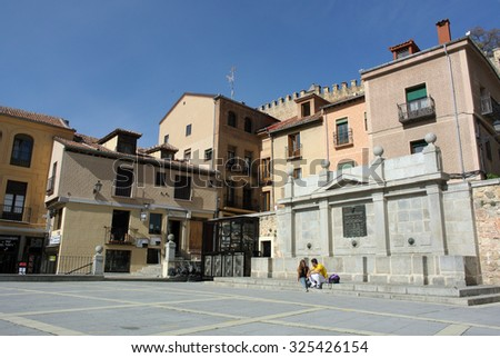 SEGOVIA, SPAIN - OCTOBER 23, 2014: A photograph of one of many streets and medieval buildings in a historic city of Segovia, Spain, Oct.23, 2014. - stock photo
