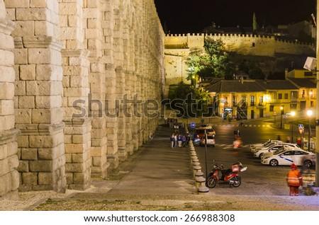 SEGOVIA, SPAIN - SEPTEMBER 20, 2014: Night view of the Roman aqueduct of Segovia, World Heritage. - stock photo