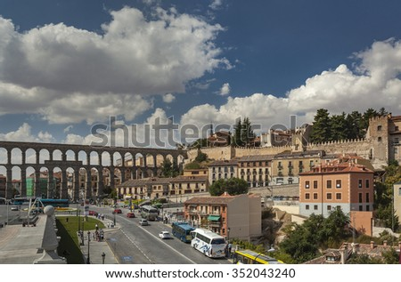 SEGOVIA, SPAIN - SEPTEMBER 23, 2011:The famous ancient aqueduct in Segovia, Castilla y Leon, Spain. - stock photo