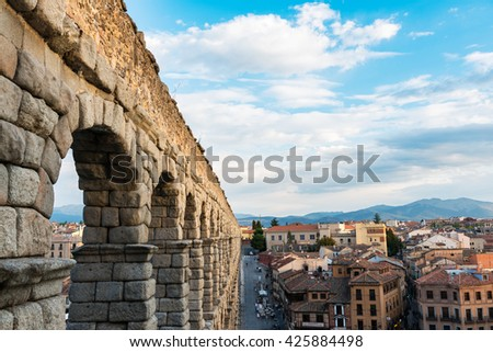 SEGOVIA, SPAIN - SEPTEMBER 26: Tourists and locals near the famous aqueduct of Segovia, one of the most significant ancient monuments left on the Iberian Peninsula, on September 26, 2015. - stock photo