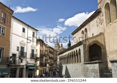 SEGOVIA, SPAIN - SEPTEMBER 14, 2014: View of the old city of Segovia, Spain, with the Church of San Martin on the right and the Cathedral bell tower in the background at the center. - stock photo