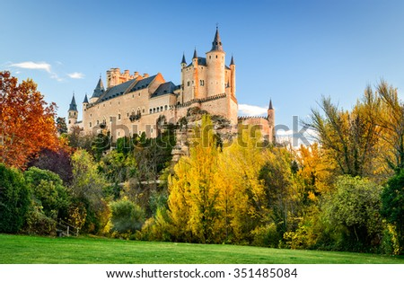 Segovia, Spain. The famous Alcazar of Segovia, rising out on a rocky crag, built in 1120.  Castilla y Leon. - stock photo
