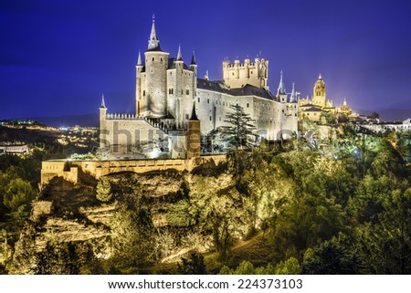 Segovia, Spain town skyline with the Alcazar at night.