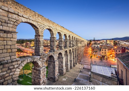 Segovia, Spain town view at Plaza del Azoguejo and the ancient Roman aqueduct. - stock photo