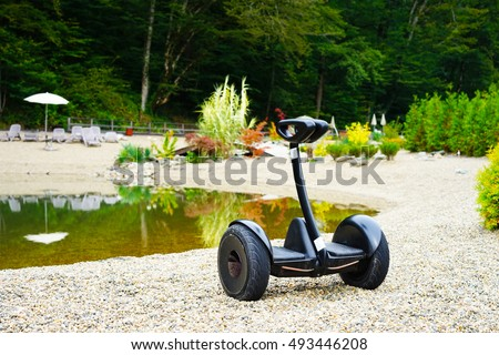 Segway on a background of lake and grass.