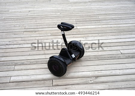 Segway on the background of the wooden floor.