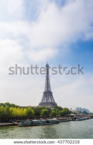 Seine in Paris and Eiffel tower in beautiful summer day in Paris - stock photo