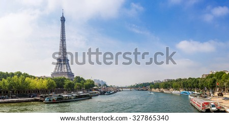 Seine in Paris and Eiffel tower in beautiful summer day in Paris, France - stock photo