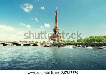 Seine in Paris with Eiffel tower in morning time - stock photo