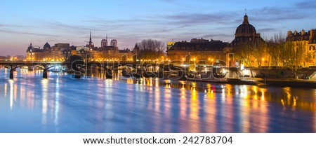 Seine river and Old Town of Paris (France) in the beautiful sunrise. A nice skyline of famous touristic destination with Notre Dame de Paris. Spectacular representative picture of French capital city. - stock photo