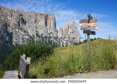Seiser Alm - Alpe di Siusi, hiking trail sign. Alpe di Siusi is the largest high altitude Alpine meadow in Europe, Italy   - stock photo