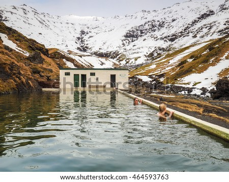 SEJLAVALLALAUG, ICELAND - 05 MAR 2016 People bathing in  a geothermal bath in Iceland, a 'must see' by tourists. March 05, 2016 in Iceland.