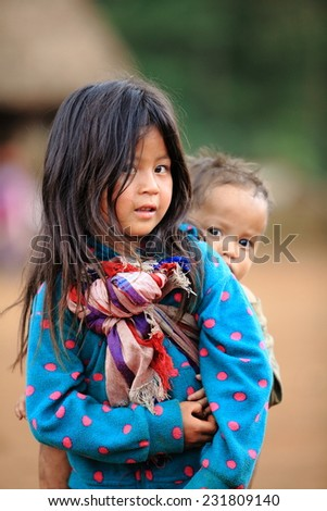 SEKONG, LAOS, APRIL 13 : An unidentified Laos little girl with brother in the village of Sekong, Laos, on April 13, 2014