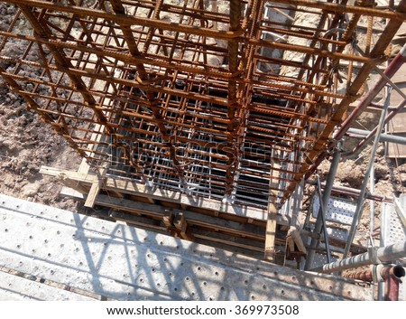 SELANGOR, MALAYSIA   AUGUST 05, 2015: Timber column form work under construction at the construction site in Malaysia. Workers using metal tubes and wood as a temporary support for the formwork. .   - stock photo