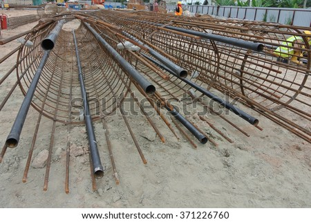 SELANGOR, MALAYSIA  FEBRUARY 10, 2015: Hot rolled deformed steel bars or steel reinforcement bar fabricated at site as concrete bore pile reinforcement bar.   - stock photo