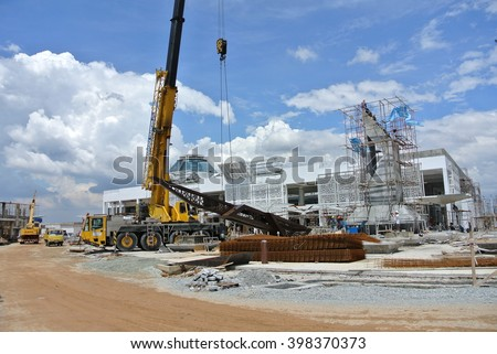 SELANGOR, MALAYSIA -February 02, 2016: Mobile crane is the heavy machine used to lifting heavy material at construction site. Powered by hydraulic arm handle by workers.