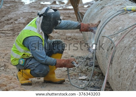 SELANGOR, MALAYSIA � FEBRUARY16, 2015: Welders welded bore pile metal casing at the construction site.
